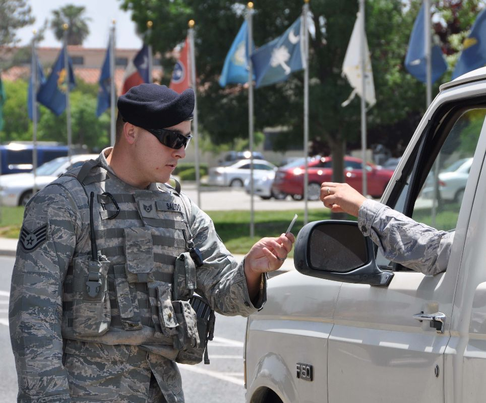 Staff Sgt. Adrian Salido, installation patrolman, 452nd Security Forces Squadron, checks the identification of a Team March member entering the main gate. March Air Reserve Base