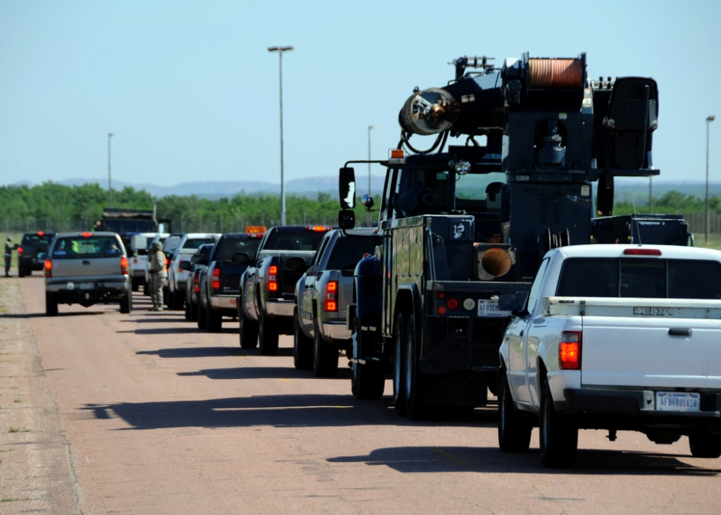 Airmen assigned to the 97th Civil Engineer Squadron drive in a convoy during a Prime Base Engineer Emergency Force exercise