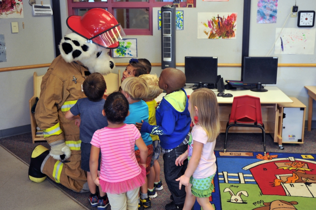 Children greet Sparky during a visit to the Altus AFB child development center, Altus Air Force Base