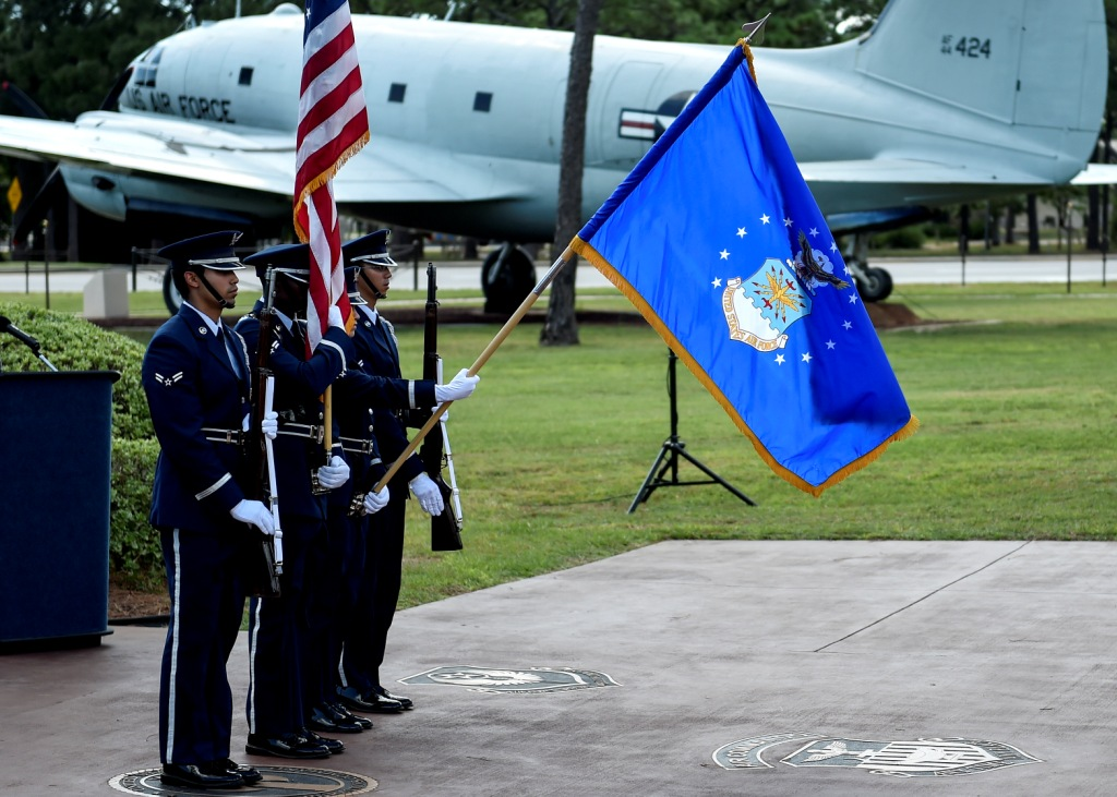 Hurlburt Field Honor Guard members present the American Flag during a POW/MIA remembrance ceremony at the Memorial Air Park on Hurlburt Field, Fla.