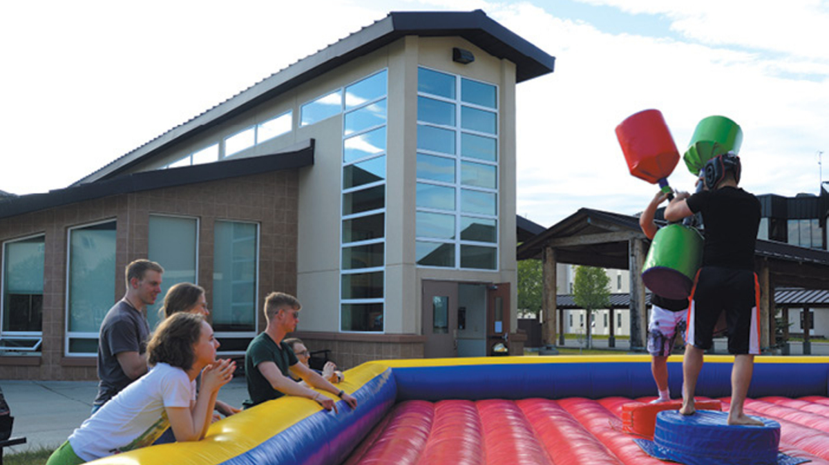 Kids playing in inflatable gladiator pit, Joint Base Elmendorf-Richardson, JBER