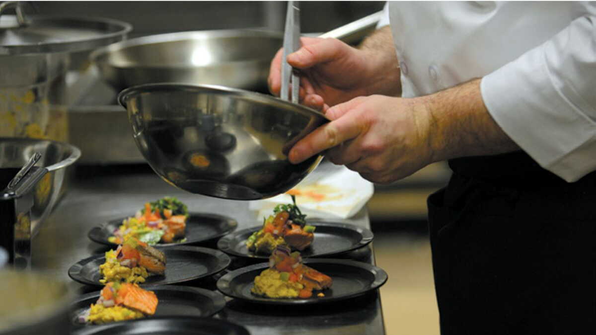 Chef making food in kitchen, Joint Base Elmendorf-Richardson, JBER