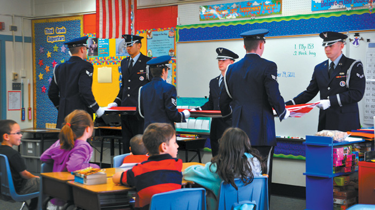Air Force Honor Guard folding flag in elementary school classroom, Joint Base Elmendorf-Richardson, JBER