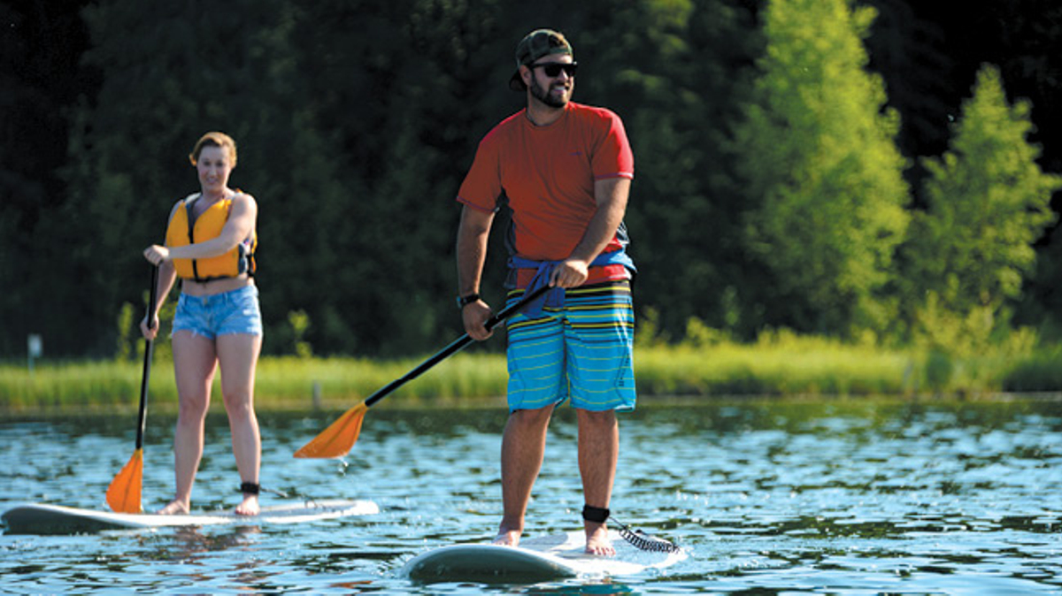 Stand up paddle boarding on a lake, Joint Base Elmendorf-Richardson, JBER