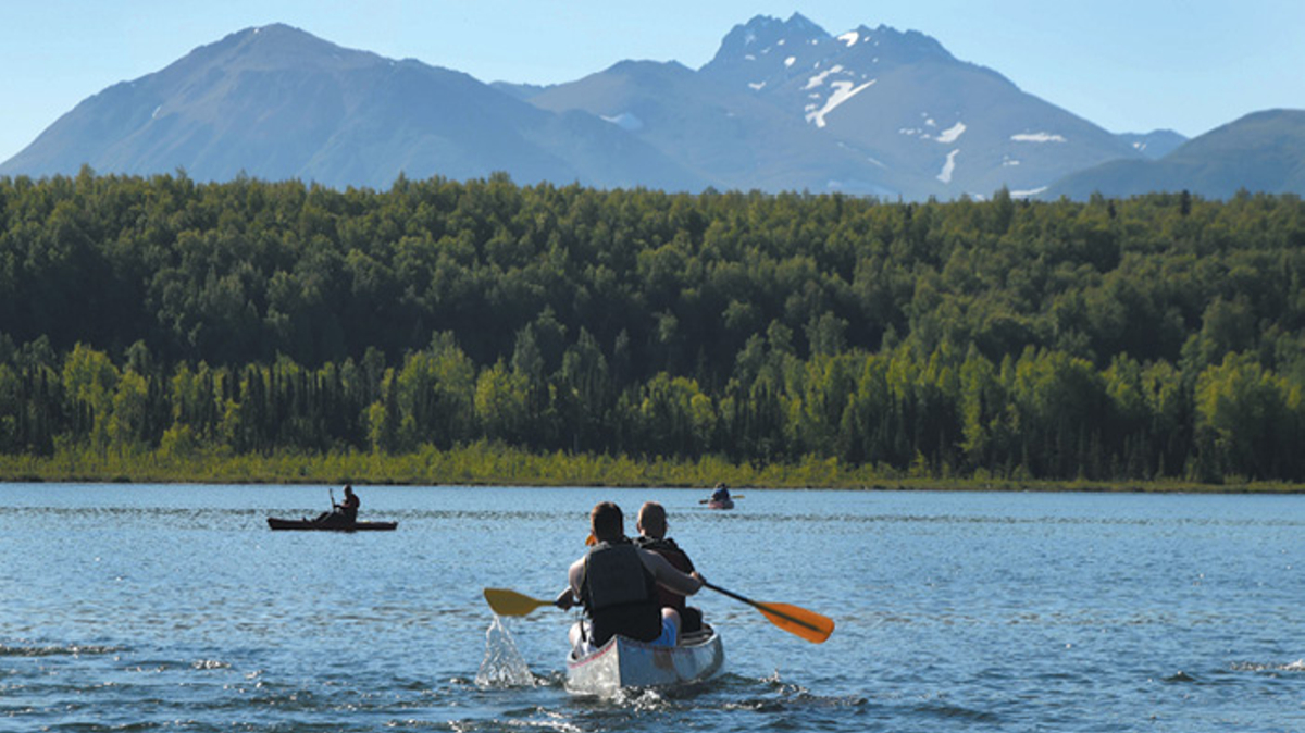 Canoeing on lake with mountain in background, Joint Base Elmendorf-Richardson, JBER